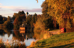 Autumn evening in Bavaria. Lake and church. Stock Images
