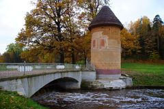 Autumn Evening and Peak Tower in the Slavyanka River Stock Photo