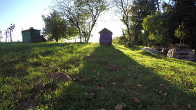 Autumn evening shadows in farm yard with  beehive. Timelapse 4k stock video footage