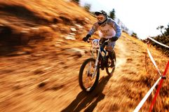 Autumn extreme mountain bike competition Royalty Free Stock Images