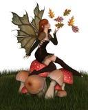 Autumn Fairy mit belaubten Flügeln auf einem Giftpilz Stockfoto