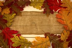Autumn, fall, background, burlap strip with leaves as border royalty free stock images