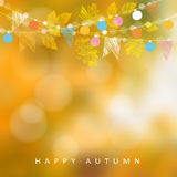 Autumn, fall background. Card with maple and oak leaves and  bokeh lights. String with party flags and light. Blurred . Royalty Free Stock Photography