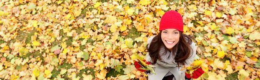 Autumn / fall banner background texture woman. Autumn / fall banner background texture of leaves with happy woman. Panoramic fall concept portrait of smiling Royalty Free Stock Photography