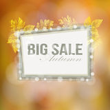 Autumn, fall big sale poster with blurred background gold leaves and lights Royalty Free Stock Photos
