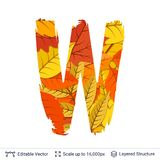 Autumn fall bright orange leaves letter. Paint brush silhouette filled with leaves pattern Royalty Free Stock Image