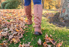 Autumn Fall with Colorful leaves and boots Royalty Free Stock Photo