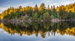 Autumn fall colours reflecting in lake Royalty Free Stock Photos