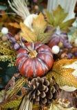 Autumn, fall decoration with a pumpkin, pine cone, leaves. Natural background. Autumn, fall decoration with a pumpkin, pine cone, leaves Stock Photography