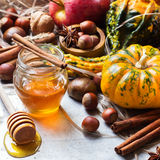 Autumn fall halloween still life composition with pumpkin nuts chestnut Stock Photos