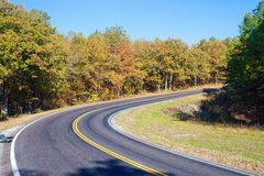 Autumn or fall highway. Country road in the autumn or fall landscape Royalty Free Stock Photo