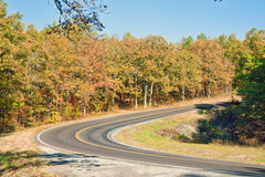 Autumn or fall highway. Country road in the autumn or fall landscape Royalty Free Stock Photography
