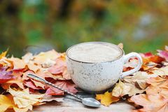 Autumn, fall leaves, hot steaming cup of coffee on wooden table background. Seasonal, morning coffee, Sunday relaxing and still li. Fe concept. With copy space stock images