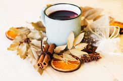 Autumn, fall leaves, hot steaming cup of glint wine. On wooden table background. Seasonal, autumnal hot wine, Autumn relaxing and still life concept stock images