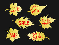 Autumn fall leaves shape sale banners in gold gradient on black. Background Stock Image