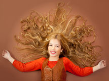 Autumn fall little girl on brown background Stock Images