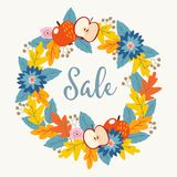 Autumn, fall sale poster with hand drawn floral wreath made of colorful oak leaves, berries, flowers and apple fruit Royalty Free Stock Image