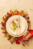 Autumn fall or thanksgiving moody table setting design. Autumn fall or thanksgiving table setting design captured from above top view, flat lay. White plate royalty free stock image