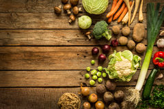 Autumn fall vegetables on vintage wooden background. Autumn fall vegetables on vintage rustic wooden background. Rural kitchen table - flat lay composition from Stock Photo