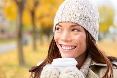 Autumn / fall woman drinking coffee looking Royalty Free Stock Photo