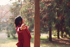 Autumn / fall woman happy in free freedom pose. With arms raised up towards the sky with smiling cheerful, elated expression of happiness. Beautiful girl in Royalty Free Stock Images
