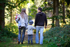 Autumn family. Young family with two kids enjoying beautiful autumn day royalty free stock images