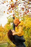 Autumn Family in Fall Park Outdoors. Royalty Free Stock Photography