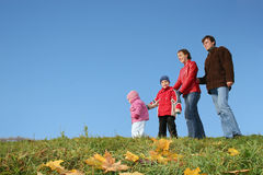 Autumn family of four. And CLEAR sky Royalty Free Stock Photography