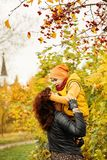 Autumn Family. Loving Mother and Son  in Fall Park Royalty Free Stock Photography