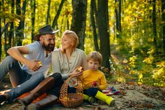 Autumn family rules respect and thankfulness for positive behaviour. Young father and mother playing with their cute and. Little son. The season outside with stock images