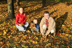 Autumn family sit. Autumn family with child sit Stock Images