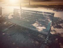 In Autumn. Fantasy fable Bench in Park with Sunrise scene. Fantasy fable scene effects applied. Blurry Bench on side walk by the Lake in the Europe and in the royalty free stock photography