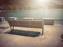 In Autumn. Fantasy fable Bench in Park with Sunrise scene. Fantasy fable scene effects applied. Blurry Bench on side walk by the Lake in the Europe and in the royalty free stock photo
