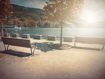 In Autumn. Fantasy fable Bench in Park with Sunrise scene. Fantasy fable scene effects applied. Blurry Bench on side walk by the Lake in the Europe and in the royalty free stock image