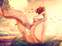 Autumn fantasy girl. Fairy in blowing chiffon dress Stock Images
