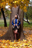Autumn fashion. Portrait of immersed, relaxed autumn fashion girl in fur coat Stock Photography