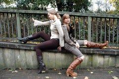 Autumn fashion. Two fashion models wearing autumn season clothes Stock Images