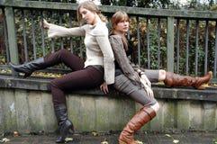 Autumn fashion. Two fashion models wearing autumn season clothes Stock Photography