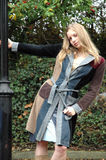 Autumn Fashion. Young woman wearing an autumn coat royalty free stock photo