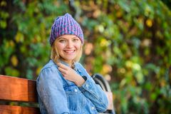 Autumn fashion accessory. Feel comfortable this fall with soft and warm stylish hat. Woman sit bench park nature. Background. Girl wear knitted hat accessory royalty free stock images