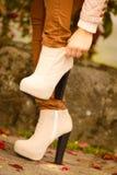 Autumn fashion. Female legs in stylish shoes Stock Photo