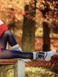 Autumn fashion. Female legs in warm socks outdoor Royalty Free Stock Image