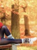Autumn fashion. Female legs in warm socks outdoor Stock Photography