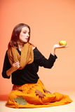 Autumn fashion girl with apple orange eye-lashes Royalty Free Stock Photo