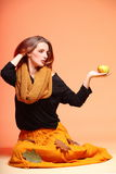 Autumn fashion girl with apple orange eye-lashes Stock Image