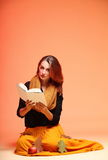 Autumn fashion girl with book orange eye-lashes Stock Photos