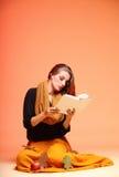 Autumn fashion girl with book orange eye-lashes Stock Photo