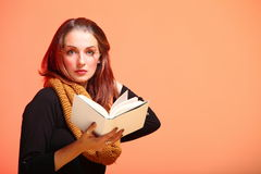 Autumn fashion girl with book orange eye-lashes Royalty Free Stock Photos