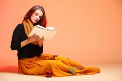 Autumn fashion girl with book orange eye-lashes. Fall. Fashion woman in autumn color student girl in full length with book long false orange eye-lashes Royalty Free Stock Photo