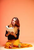Autumn fashion girl with book orange eye-lashes Stock Photography